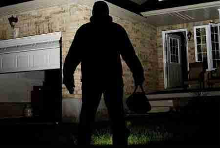 burglar invading a home