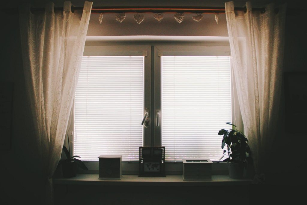 tinted reflective windows curtains and blinds