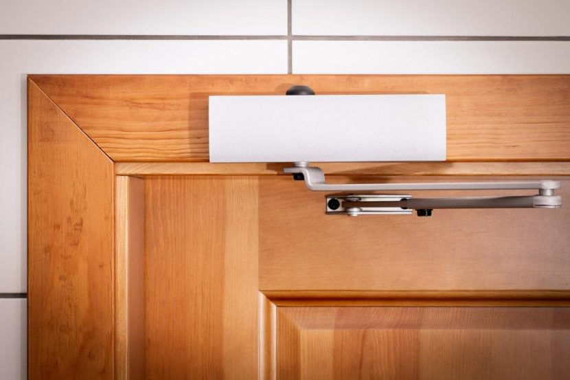 different types of commercial door closers