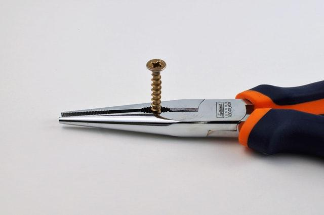 attempt needle nose pliers or tweezers to remove the key