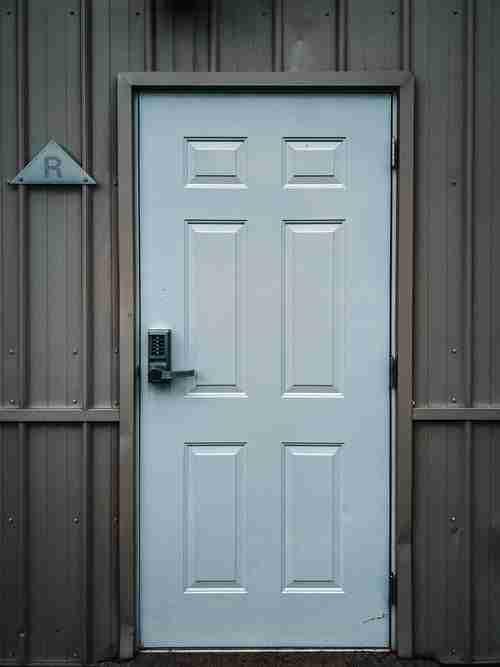 white door with electronic lock