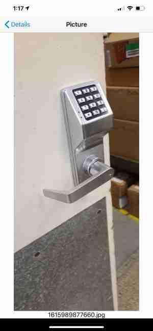 locksmith replacing deadbolt lock with electronic lock